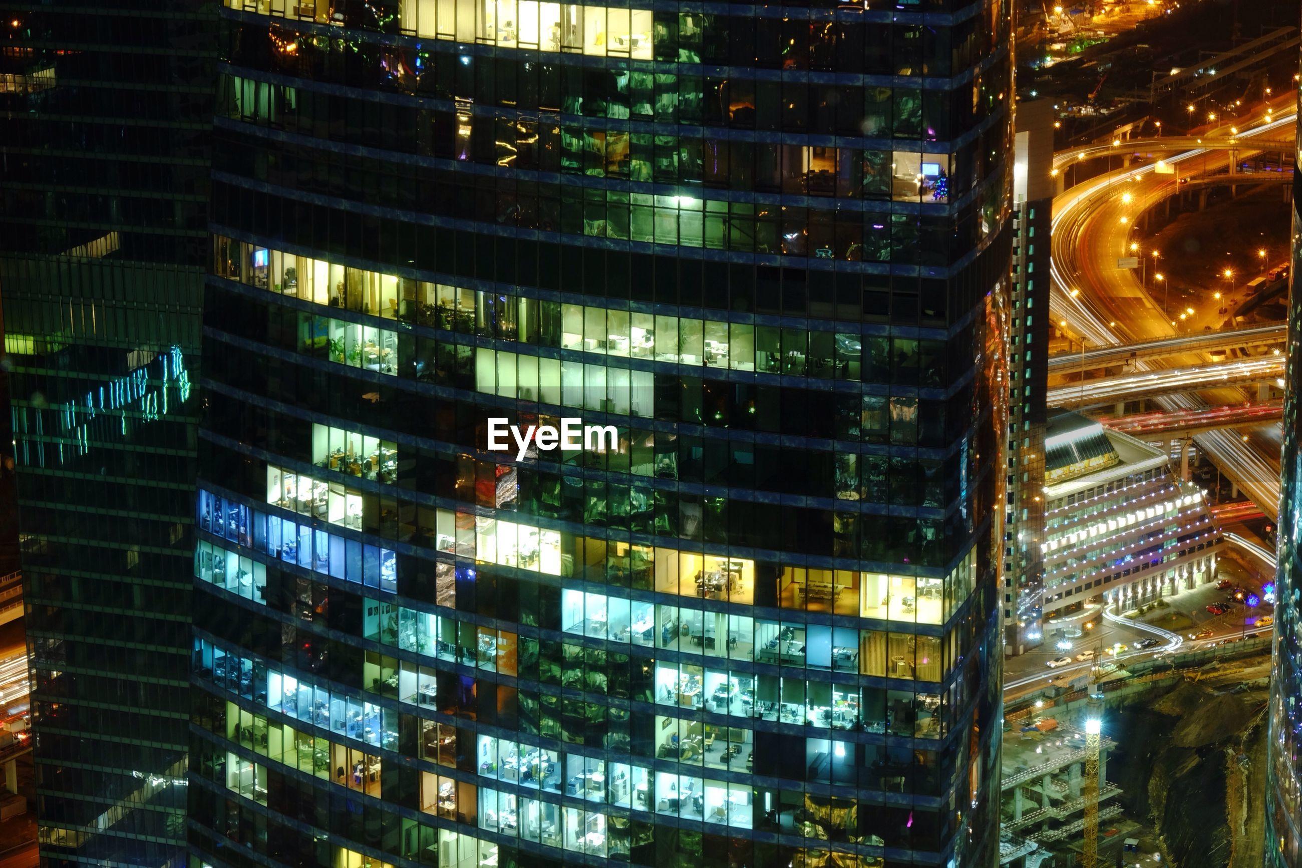 Modern illuminated building in city at night