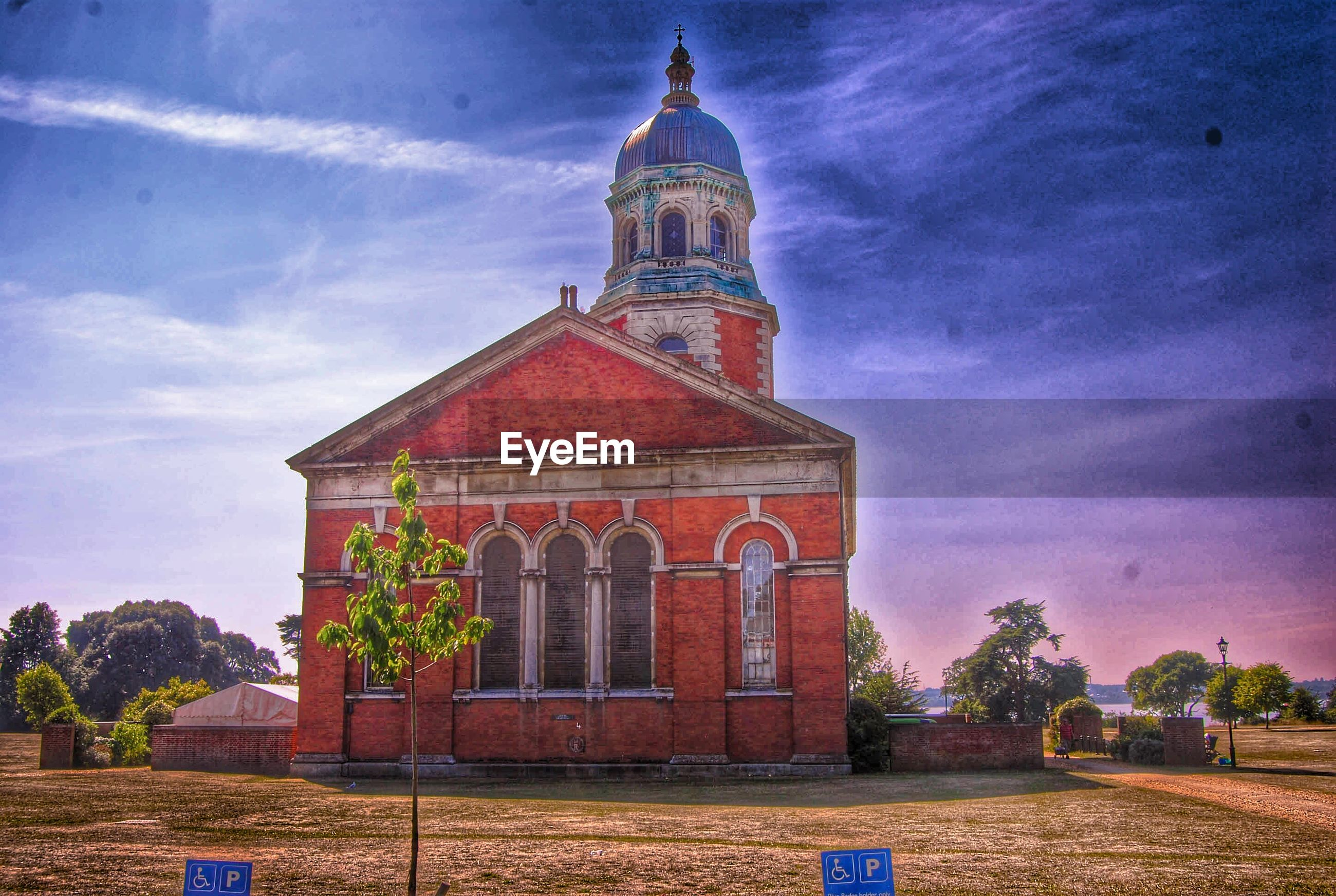 architecture, building exterior, built structure, place of worship, sky, religion, spirituality, church, cloud - sky, tree, cloud, low angle view, blue, famous place, travel destinations, outdoors, facade, cathedral