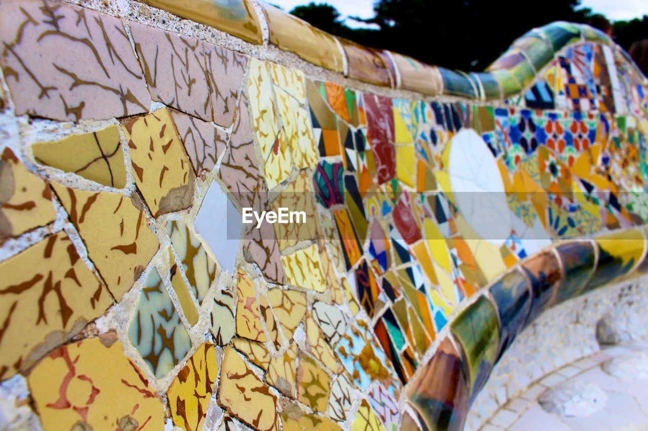 Close-up of mosaic tile bench at park guell