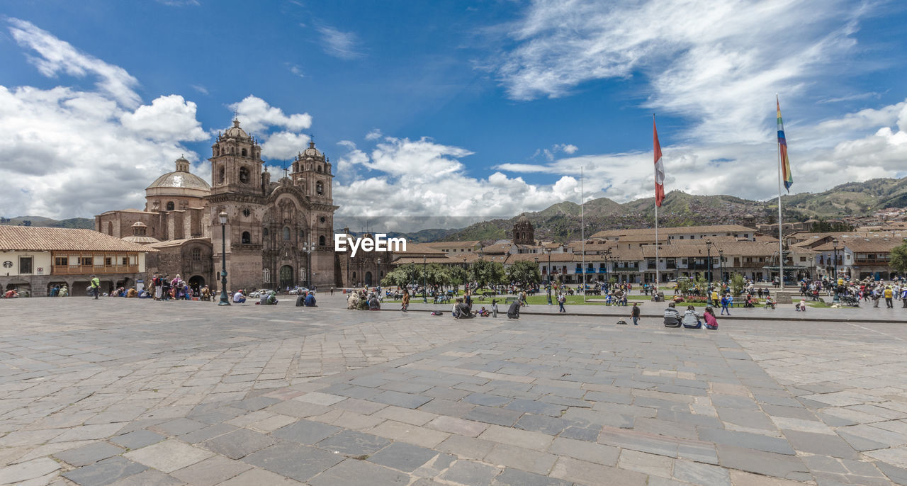 architecture, built structure, building exterior, group of people, sky, crowd, history, large group of people, travel destinations, tourism, cloud - sky, the past, real people, travel, building, city, tourist, women, place of worship, day, outdoors