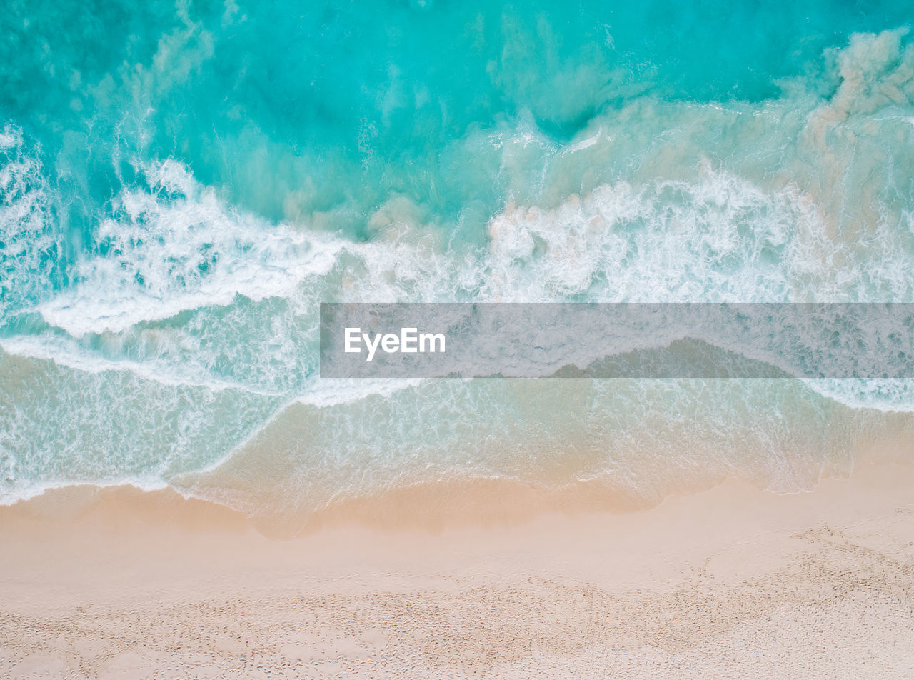 sea, water, wave, land, motion, beach, beauty in nature, power in nature, nature, no people, sport, aquatic sport, day, scenics - nature, power, outdoors, sand, turquoise colored