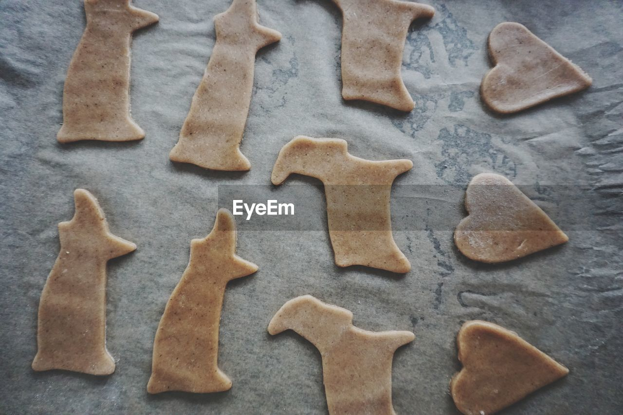 Close-Up Of Various Shape Cookies On Baking Sheet