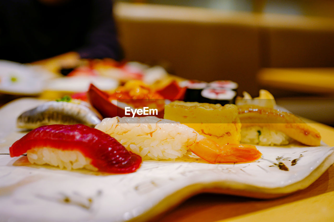 food, food and drink, healthy eating, freshness, table, close-up, indoors, ready-to-eat, wellbeing, selective focus, plate, still life, fruit, serving size, no people, focus on foreground, vegetable, indulgence, seafood, tomato, japanese food, breakfast, temptation, tray