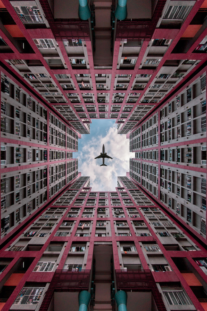 building exterior, architecture, built structure, building, low angle view, real people, day, city, men, window, geometric shape, people, outdoors, residential district, lifestyles, reflection, digital composite, ceiling, directly below