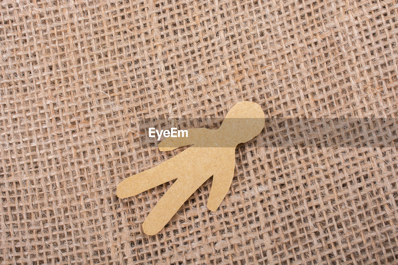 no people, art and craft, indoors, pattern, textured, craft, close-up, creativity, studio shot, shape, high angle view, single object, representation, brown, communication, sand, backgrounds, full frame, land, star shape