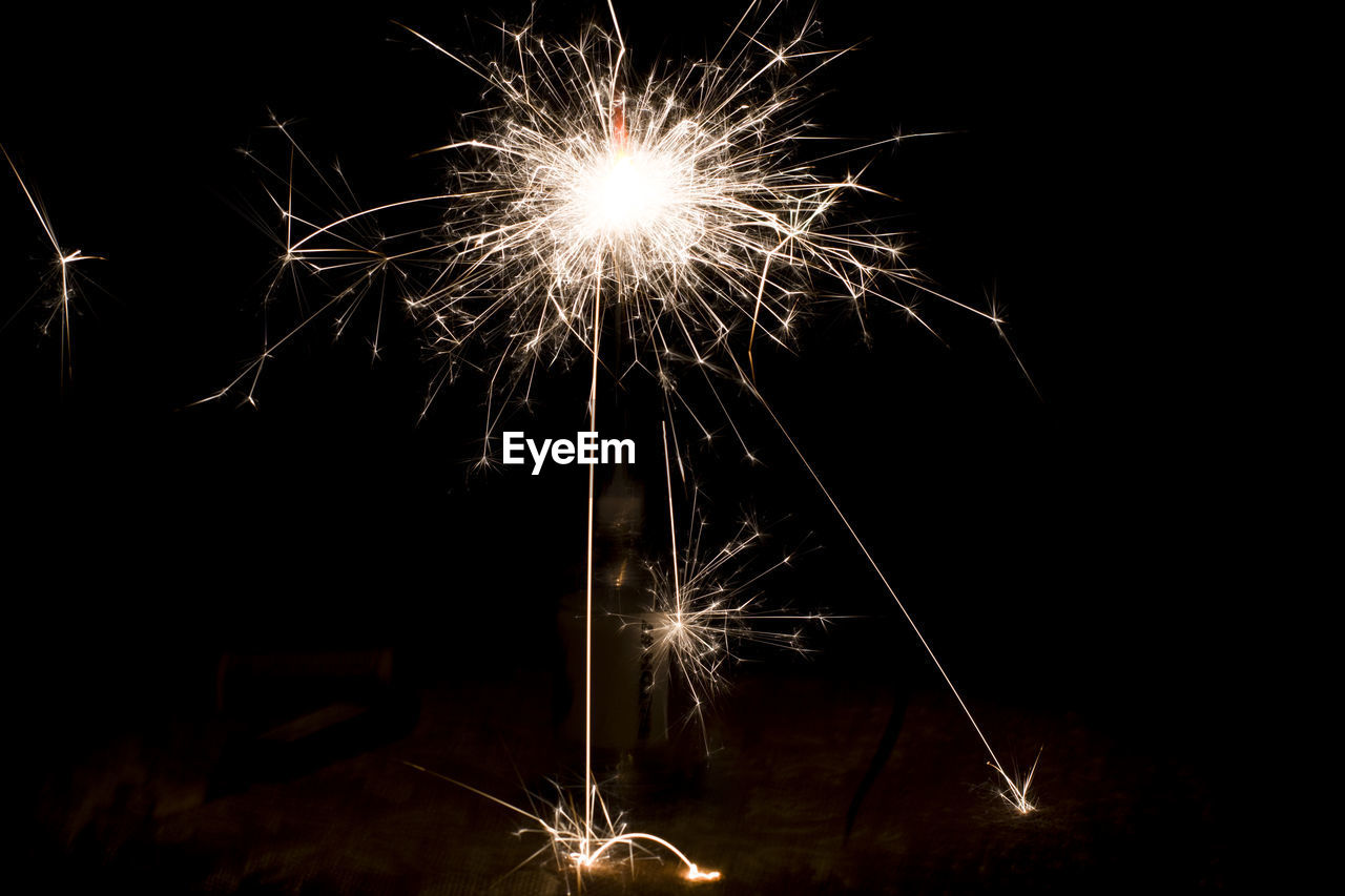 night, sparks, firework - man made object, firework display, long exposure, glowing, sparkler, arts culture and entertainment, exploding, illuminated, celebration, motion, event, burning, no people, firework, blurred motion, low angle view, outdoors, sky, close-up