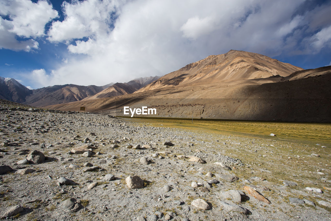 mountain, sky, cloud - sky, environment, scenics - nature, landscape, beauty in nature, tranquil scene, nature, non-urban scene, mountain range, land, tranquility, no people, rock, day, desert, solid, remote, climate, arid climate, outdoors