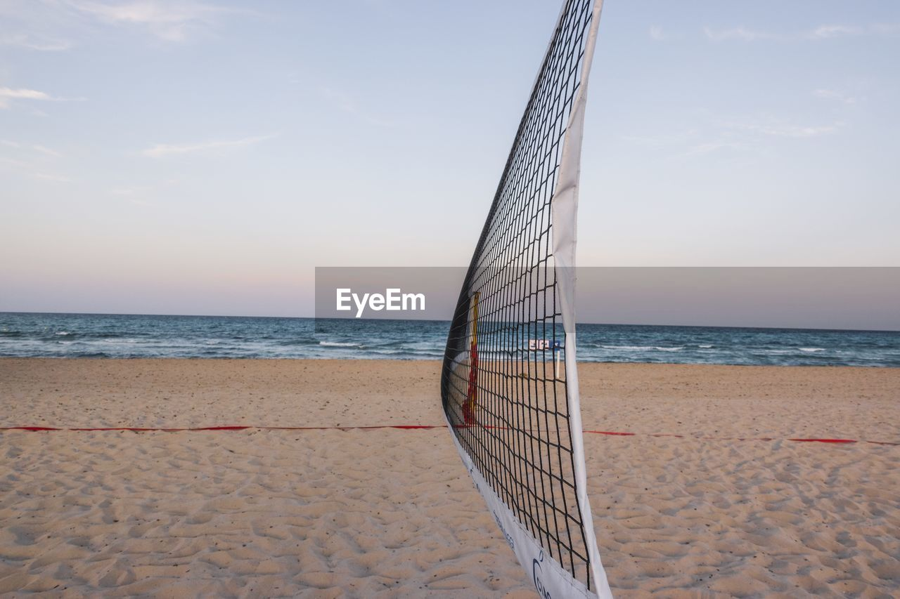 sea, beach, horizon, land, water, sky, horizon over water, sand, scenics - nature, sport, beauty in nature, nature, net - sports equipment, day, outdoors, tranquility, no people, tranquil scene, beach volleyball