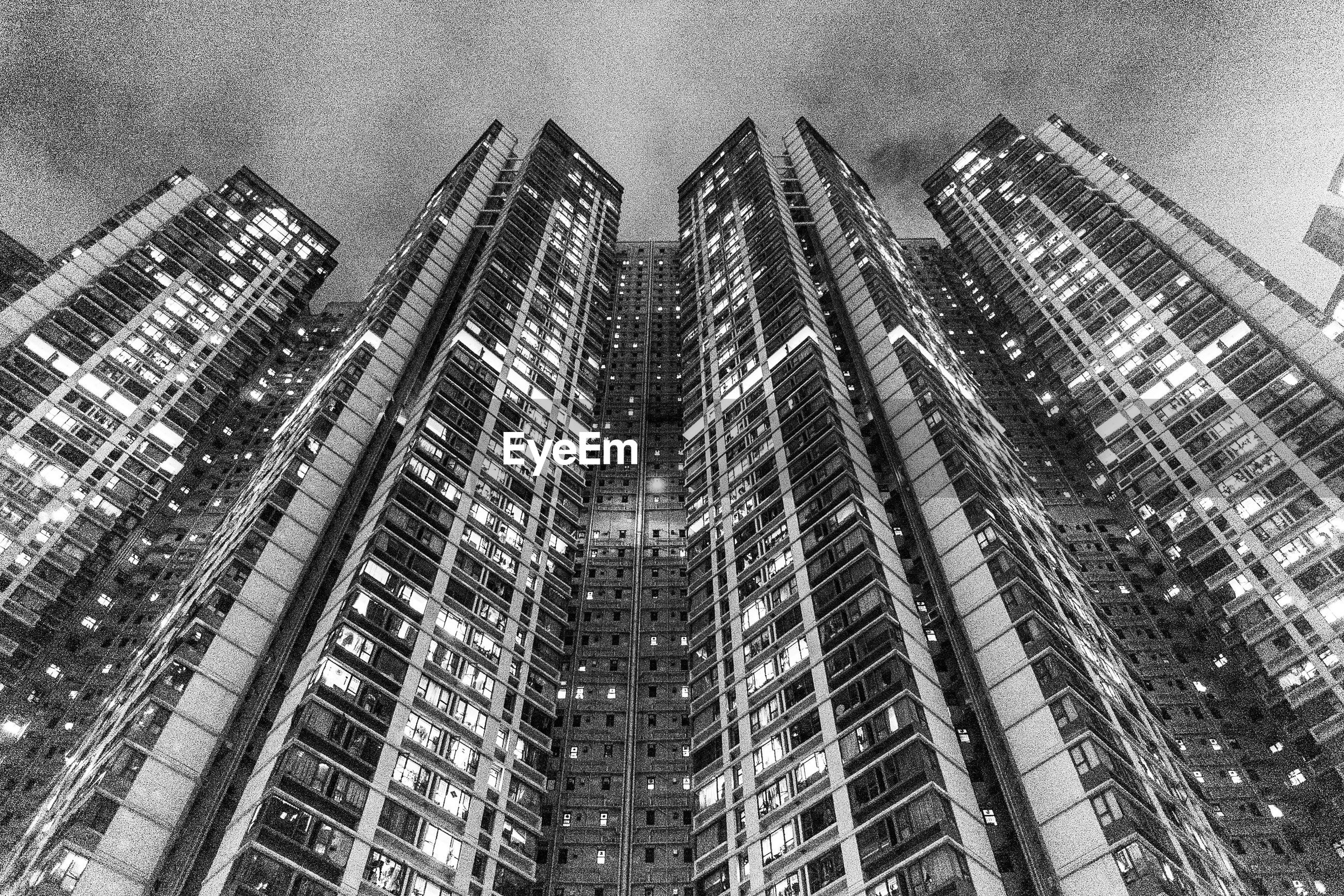 architecture, built structure, building exterior, metropolis, black and white, city, building, metropolitan area, skyscraper, office building exterior, monochrome, monochrome photography, sky, tower block, low angle view, cityscape, no people, office, residential district, tower, nature, residential area, urban area, outdoors, day, skyline, condominium, downtown, development