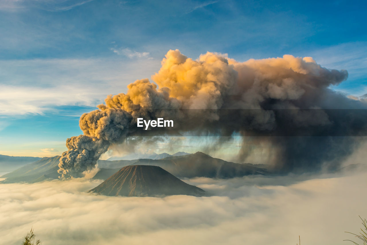 Smoke emitting from volcanic bromo mountain against sky