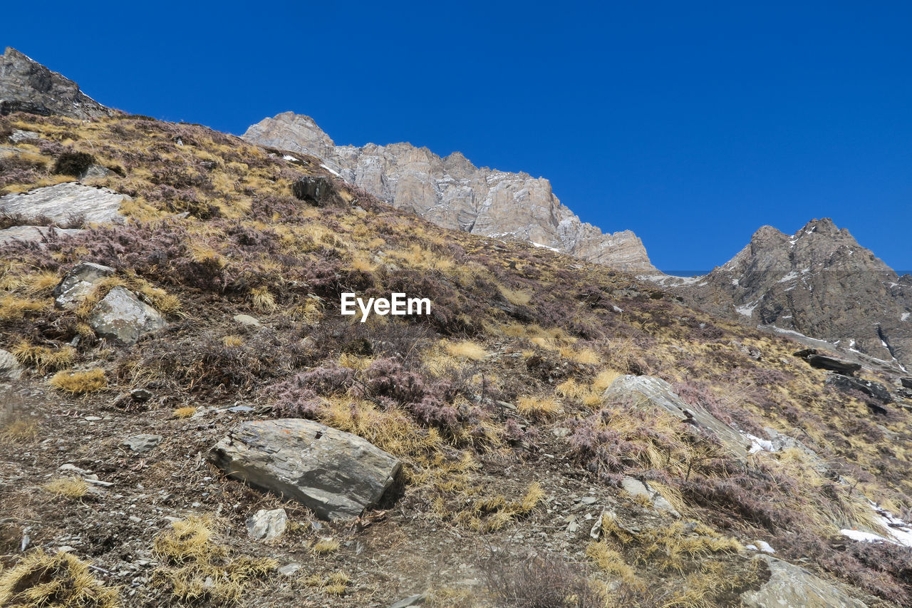 mountain, sky, rock, beauty in nature, nature, clear sky, no people, rock - object, environment, scenics - nature, solid, blue, tranquility, tranquil scene, day, landscape, mountain peak, non-urban scene, physical geography, outdoors, mountain range, formation