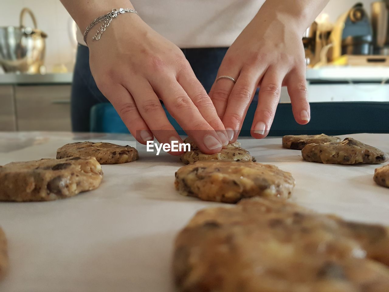 Cookies,midsection of woman preparing food on table