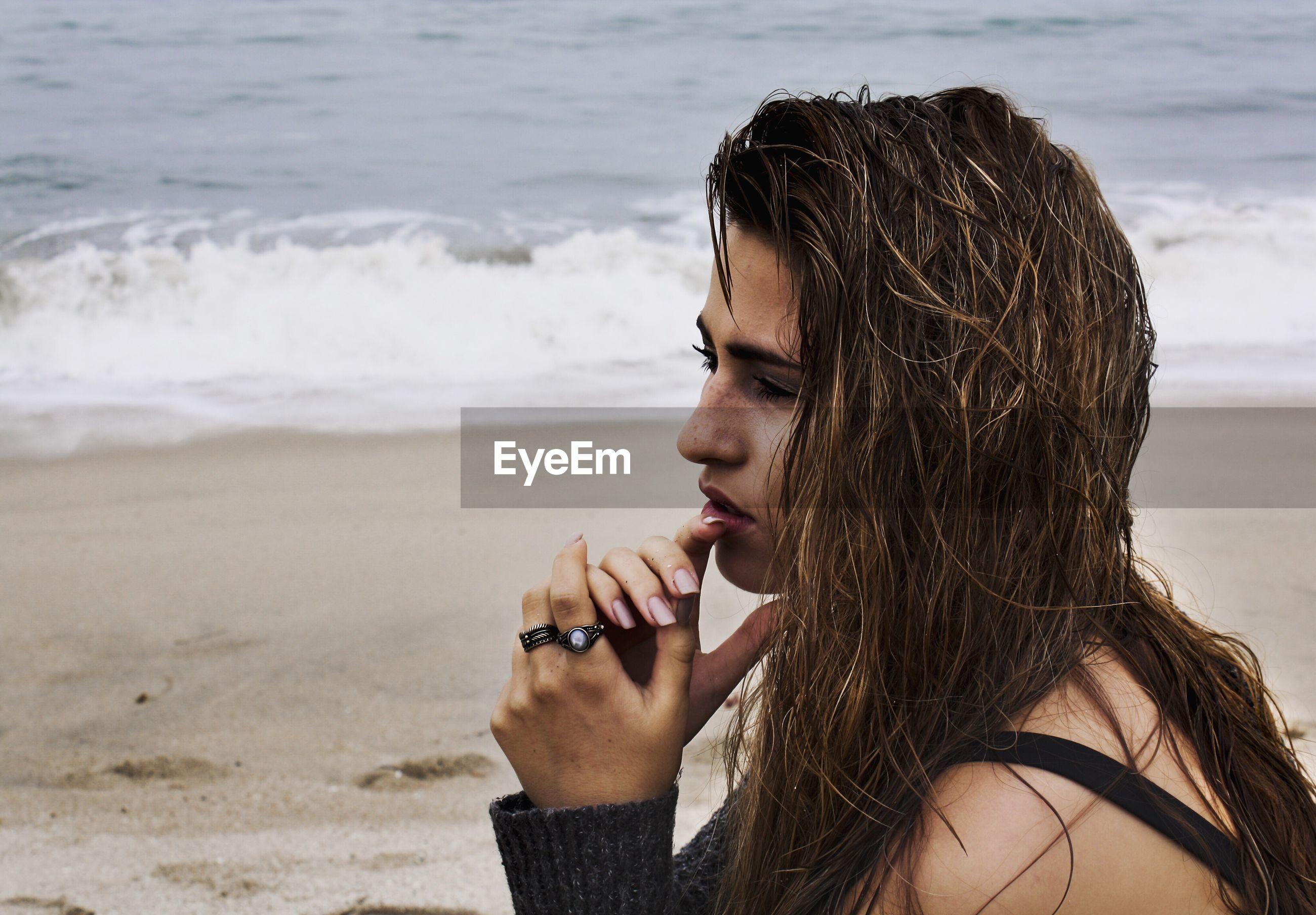 Woman thinking on beach