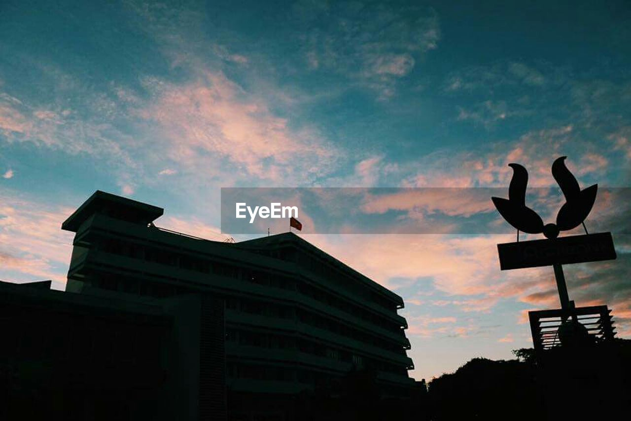 sunset, silhouette, sky, architecture, low angle view, built structure, outdoors, no people, cloud - sky, building exterior, city, bird, day, nature