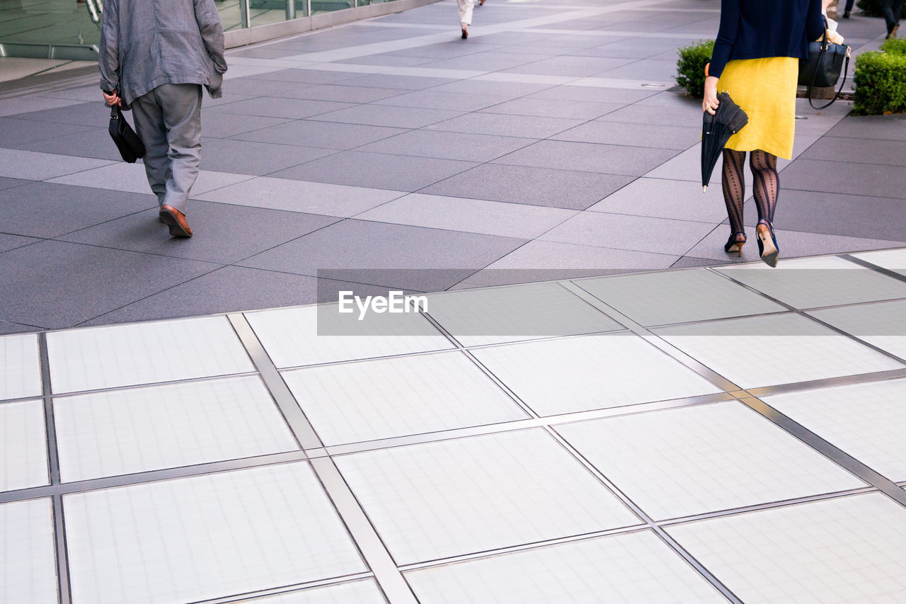 Low Section Of People Walking In Pavement