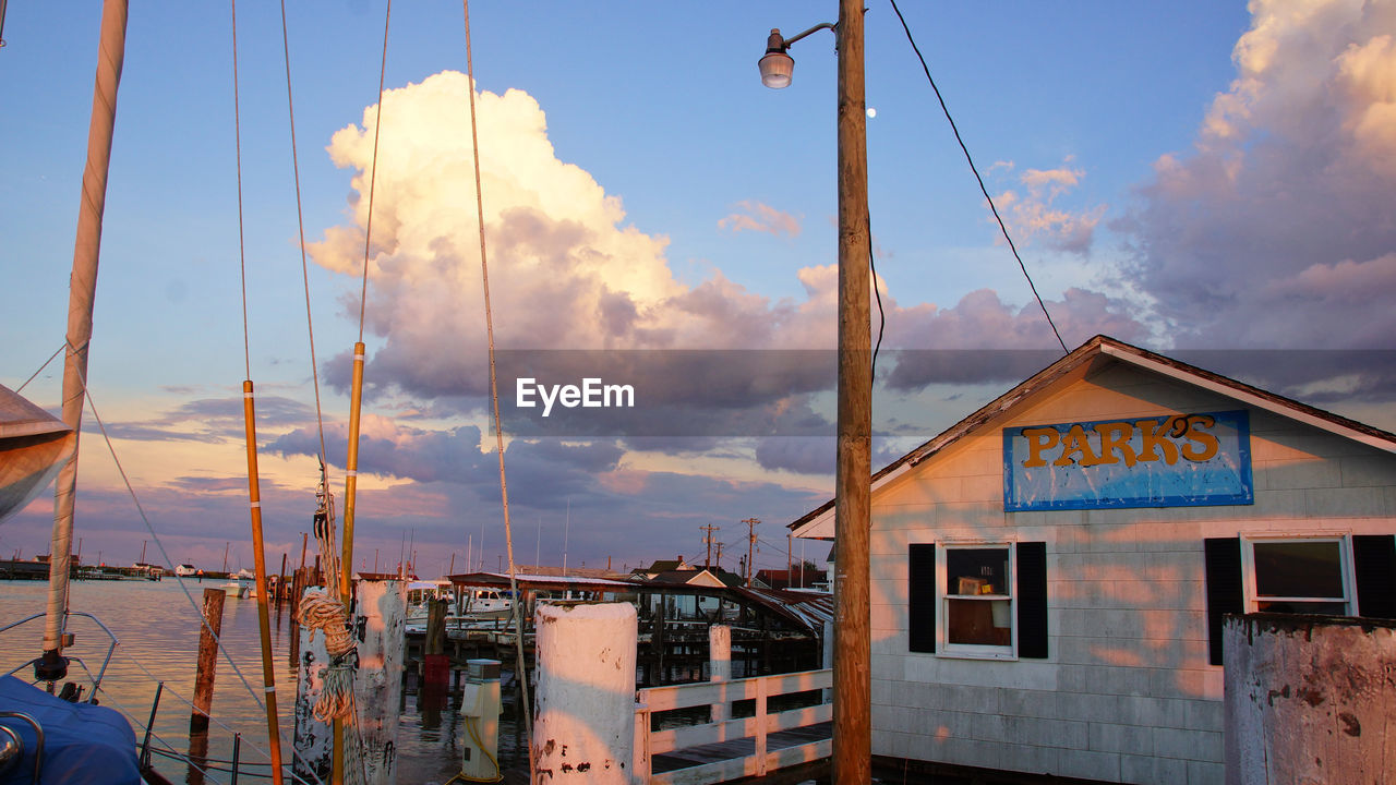 Tangier Island dock Chespeake Bay Tangier Island Building Exterior Commercial Dock Days End Type Image Sky Storm Clouds At Sunset Warf