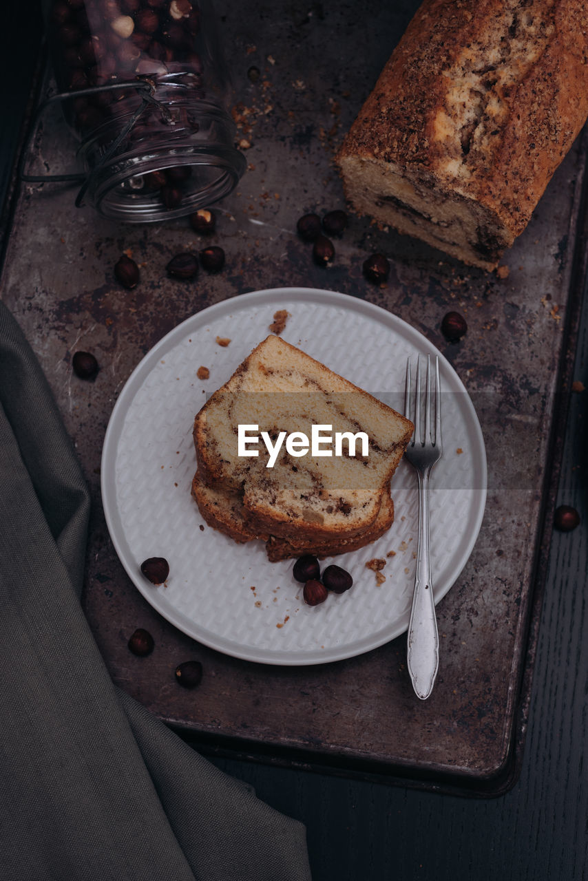 food, food and drink, freshness, table, eating utensil, kitchen utensil, indoors, high angle view, sweet food, bread, still life, slice, fork, ready-to-eat, plate, dessert, household equipment, sweet, wood - material, knife, no people, table knife, temptation, breakfast, snack