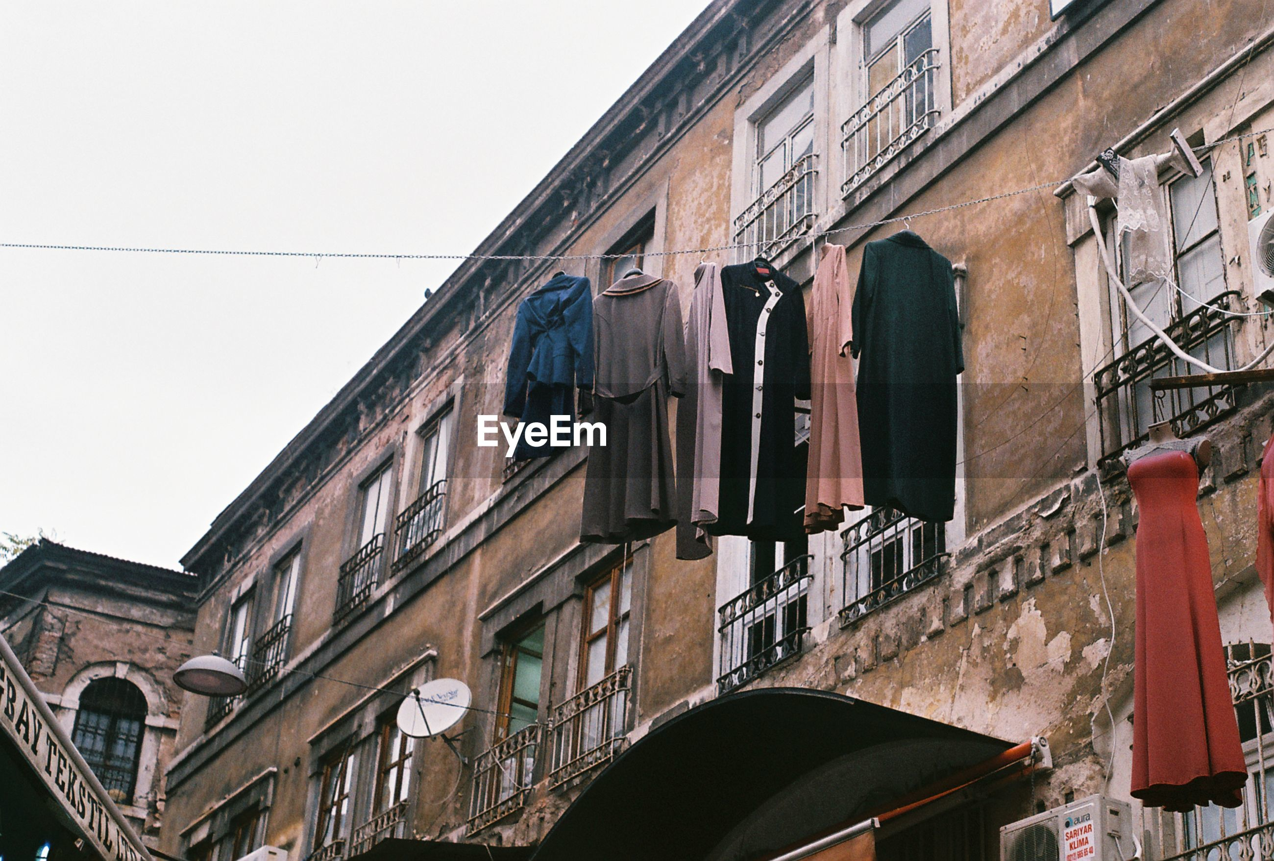 Low angle view of clothes hanging outside residential building