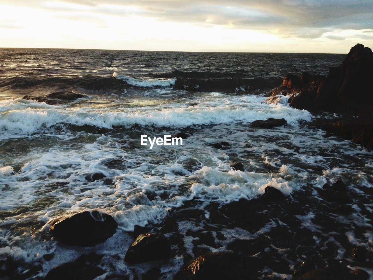 sea, water, nature, beauty in nature, rock - object, sunset, wave, horizon over water, scenics, tranquility, tranquil scene, beach, no people, sky, outdoors, motion, day, power in nature