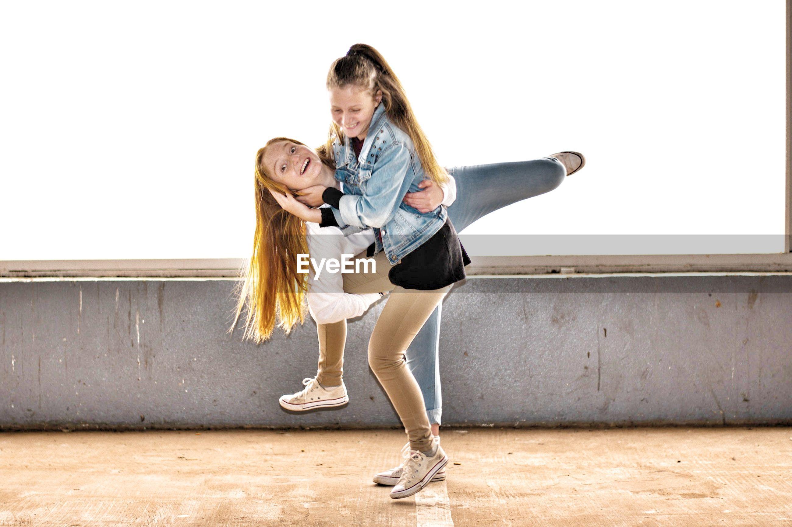 Playful siblings on walkway