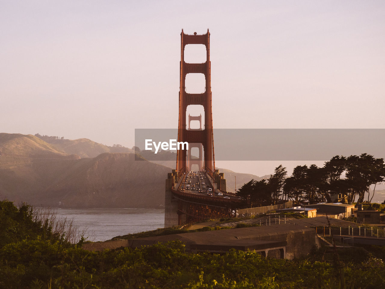 Golden Gate Bridge Over San Francisco Bay By Mountain Against Sky During Sunset