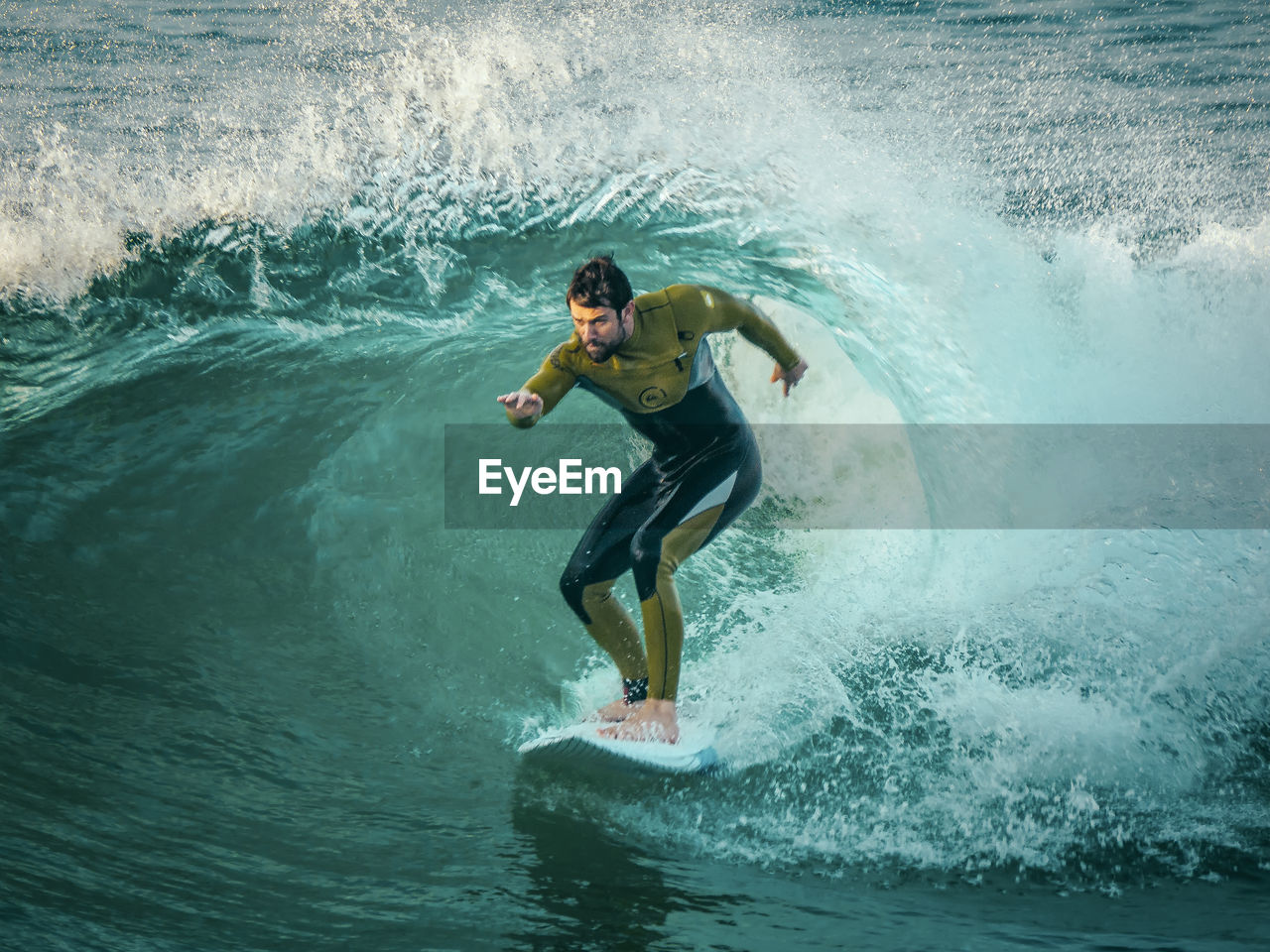 motion, water, splashing, one person, speed, sea, wave, waterfront, leisure activity, day, men, real people, adventure, lifestyles, surfing, nature, outdoors, extreme sports, risk, sport, force, power in nature, full length, one man only, young adult, adult, adults only, people
