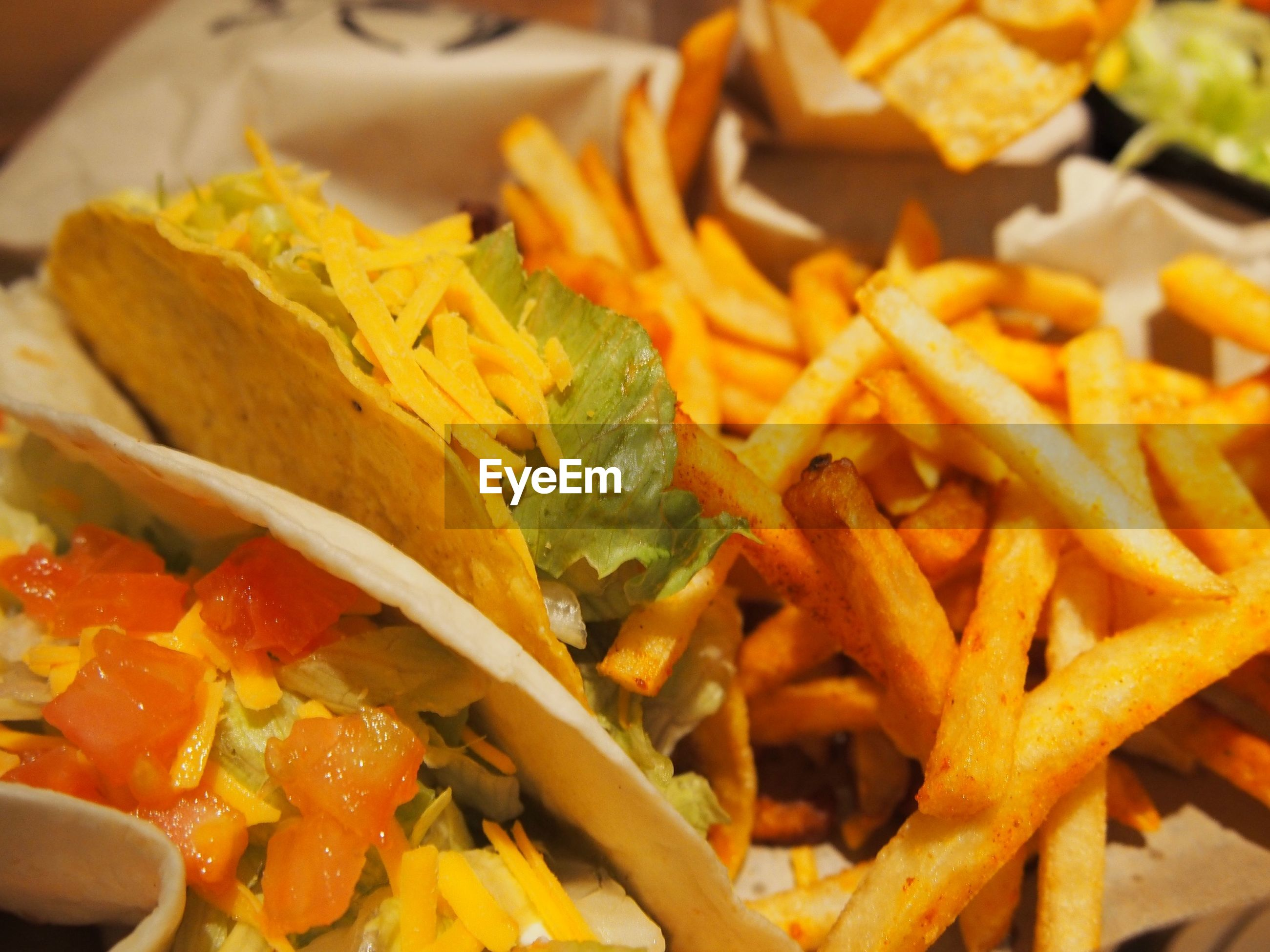 High angle view of tacos and french fries in plate