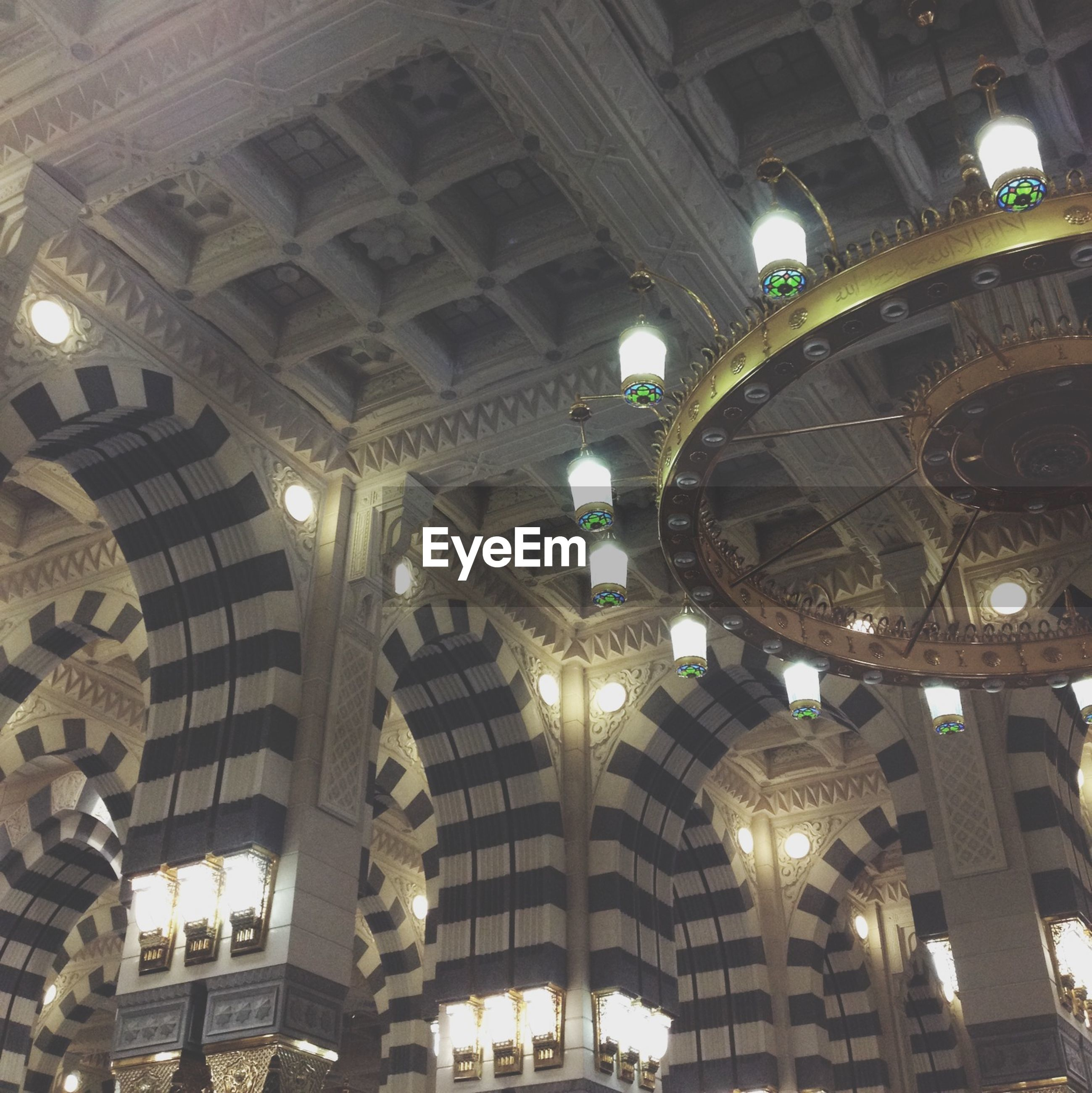 architecture, built structure, low angle view, ceiling, indoors, illuminated, arch, lighting equipment, building exterior, architectural feature, famous place, travel destinations, interior, chandelier, tourism, night, ornate, dome, travel, no people