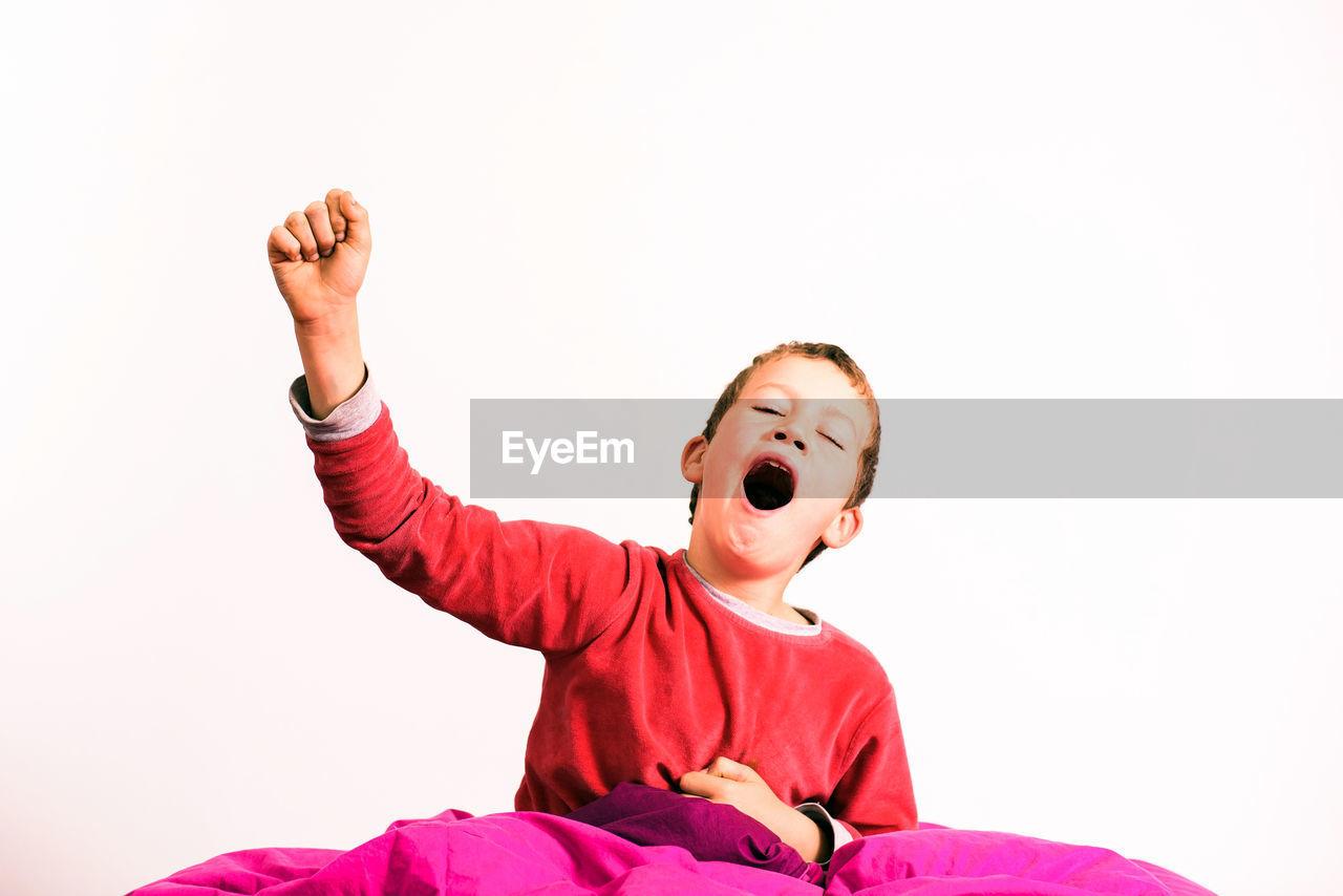 HAPPY BOY AGAINST WHITE BACKGROUND