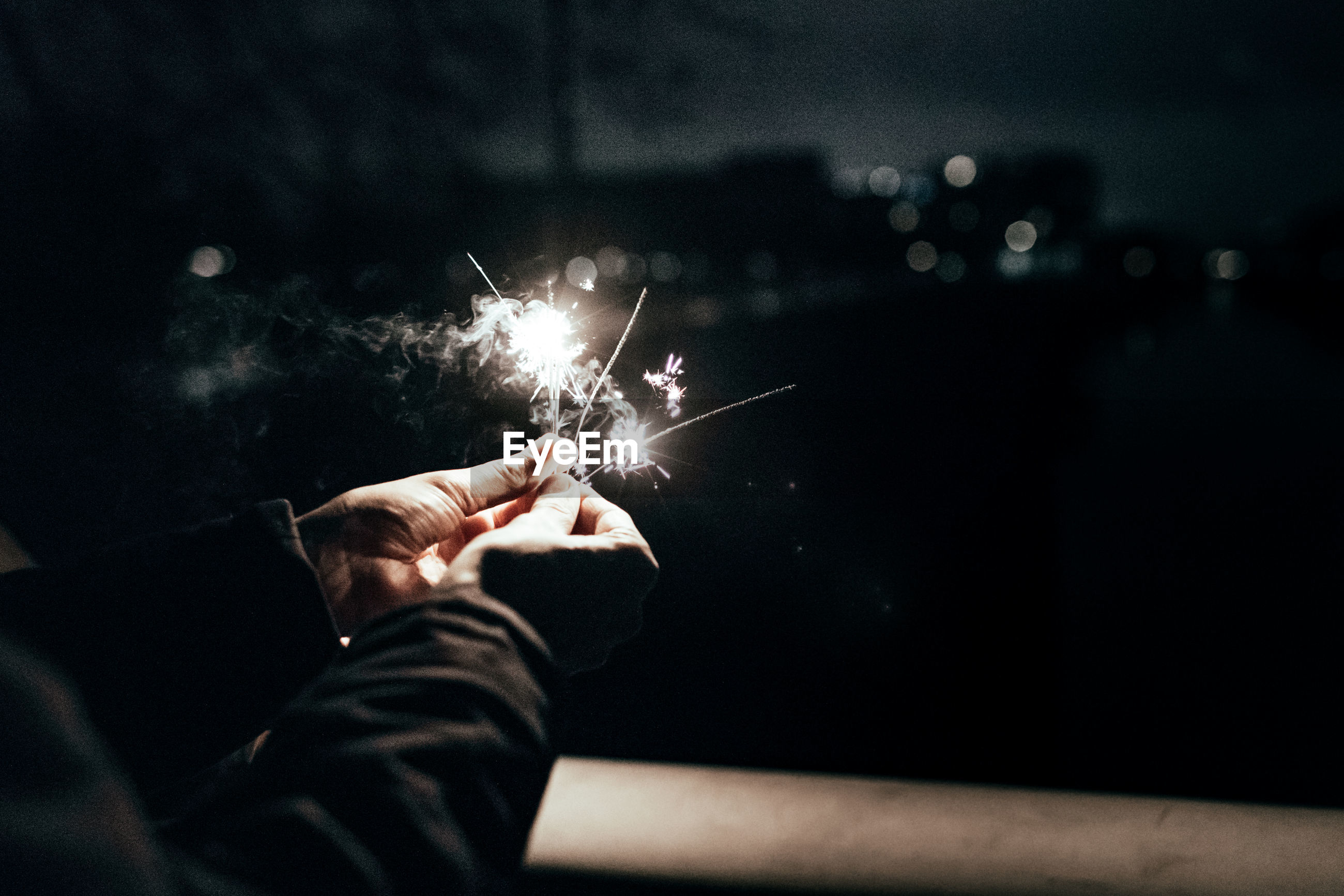 Close-up of person holding sparklers