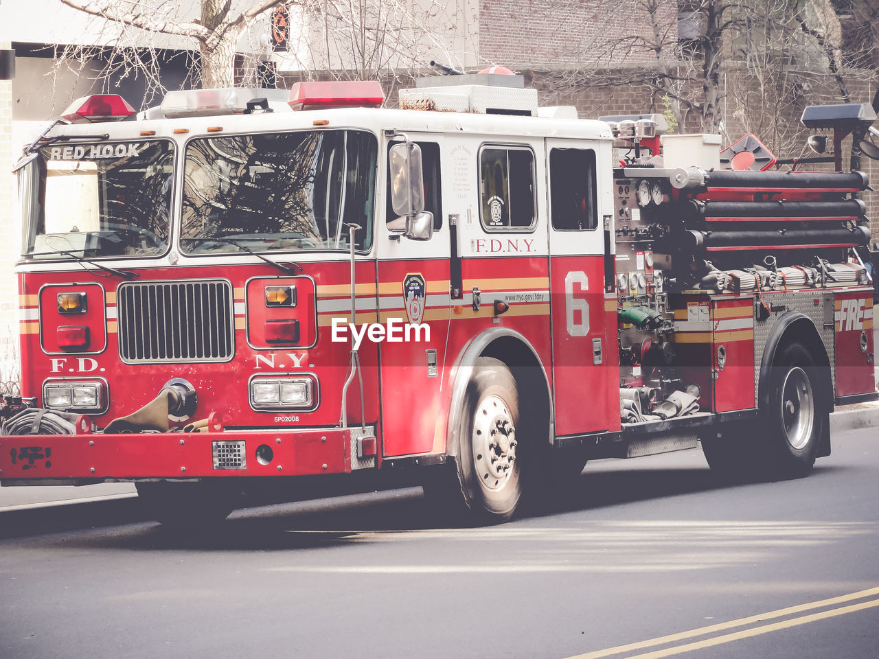 transportation, land vehicle, mode of transportation, truck, red, fire engine, city, accidents and disasters, emergency services occupation, street, motor vehicle, architecture, rescue, occupation, road, protection, firefighter, day, commercial land vehicle, car, rescue worker, wheel