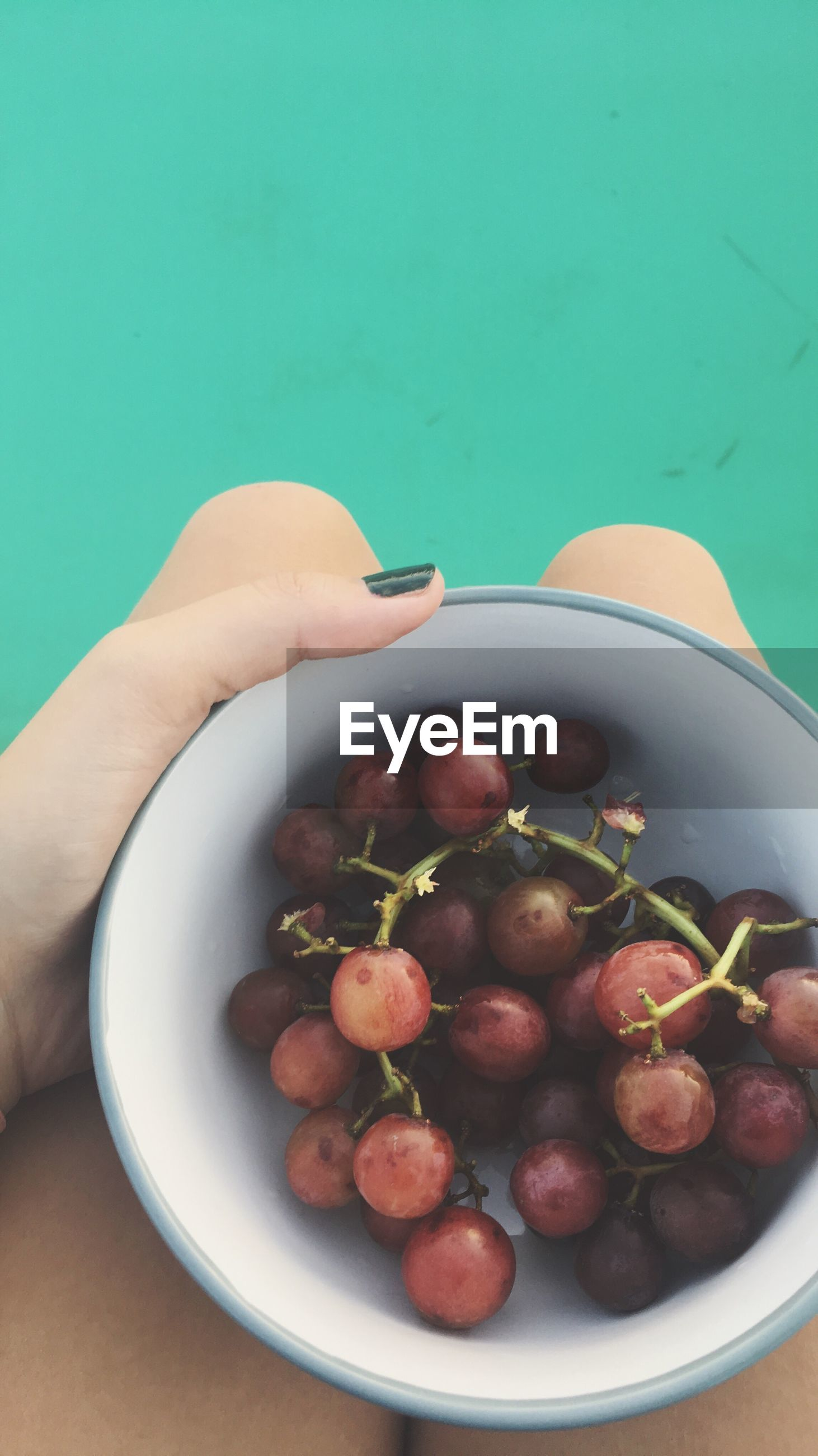 food and drink, fruit, food, healthy eating, freshness, bowl, human hand, table, high angle view, human body part, one person, indoors, grape, nut - food, close-up, real people, day, ready-to-eat, people