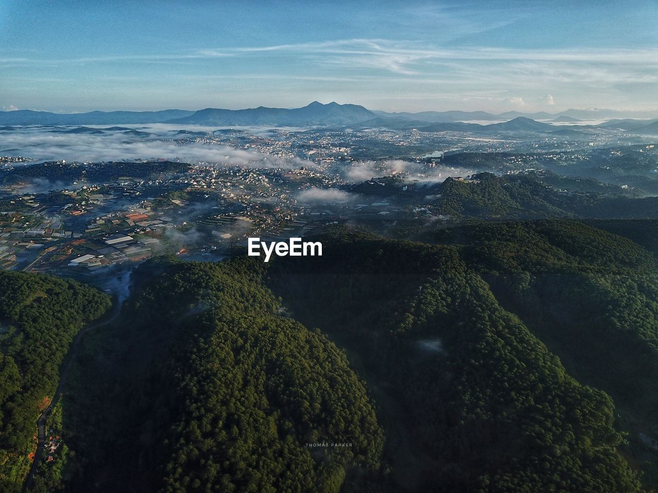 AERIAL VIEW OF LANDSCAPE AND MOUNTAINS