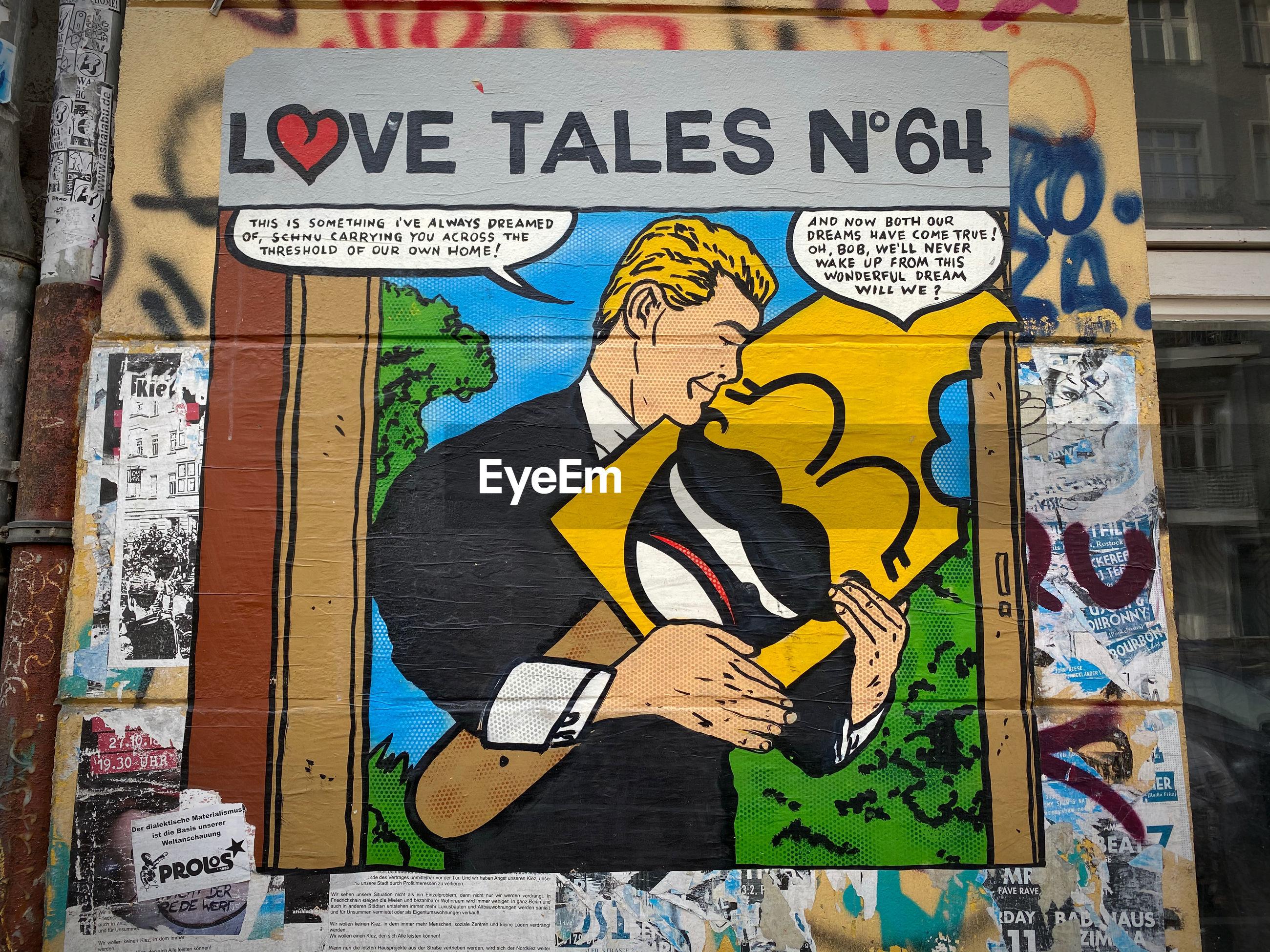 GRAFFITI ON BRICK WALL WITH TEXT