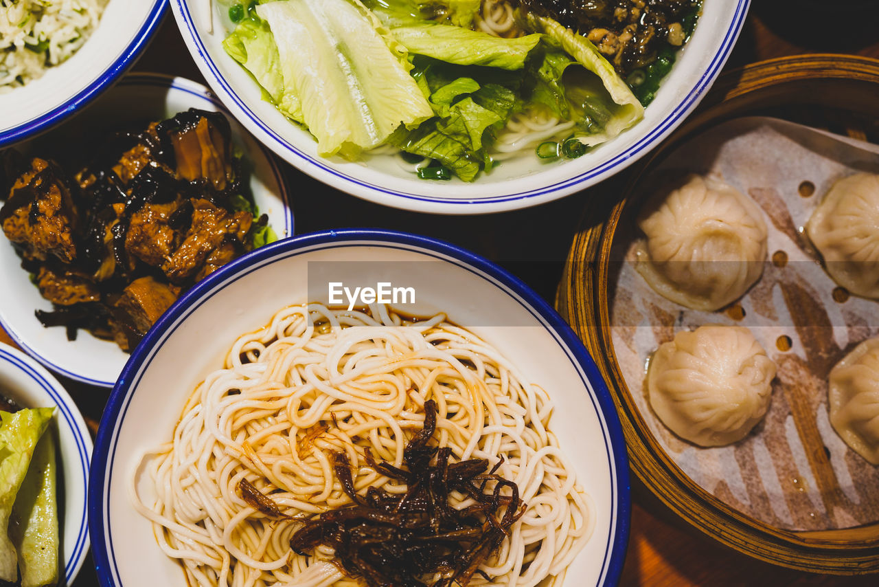 food, food and drink, freshness, ready-to-eat, healthy eating, wellbeing, table, still life, bowl, high angle view, pasta, no people, indoors, serving size, italian food, vegetable, asian food, close-up, meal, chopsticks, japanese food, chinese food, spaghetti, temptation, tray