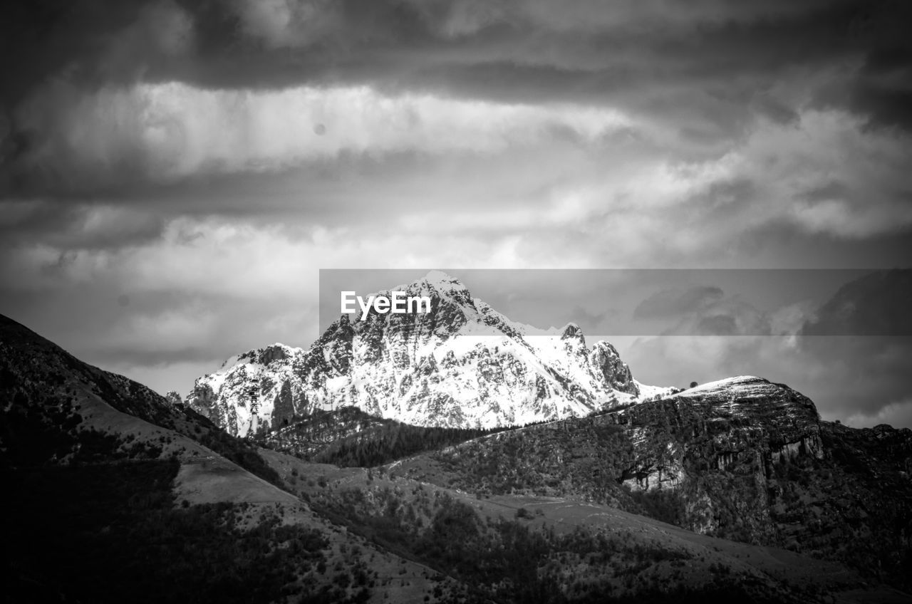 cloud - sky, mountain, sky, scenics - nature, beauty in nature, tranquility, tranquil scene, environment, mountain range, nature, landscape, no people, non-urban scene, snow, mountain peak, idyllic, day, winter, cold temperature, snowcapped mountain, outdoors