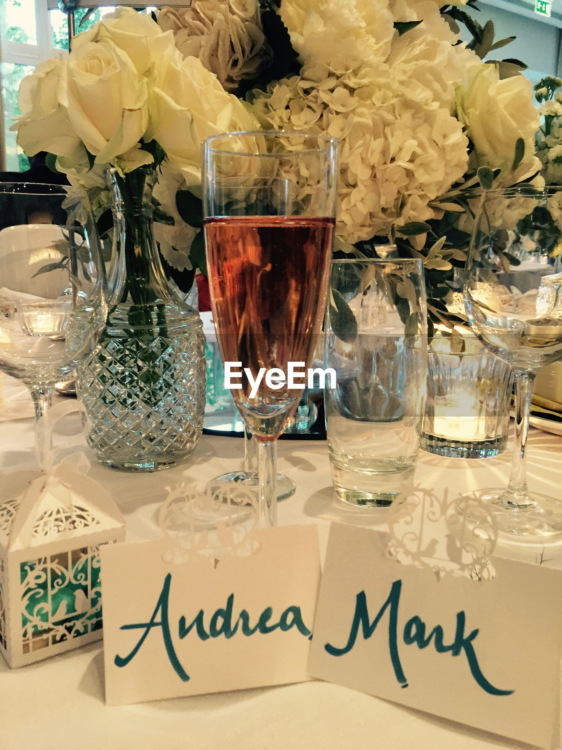 Wineglass with name tags on table
