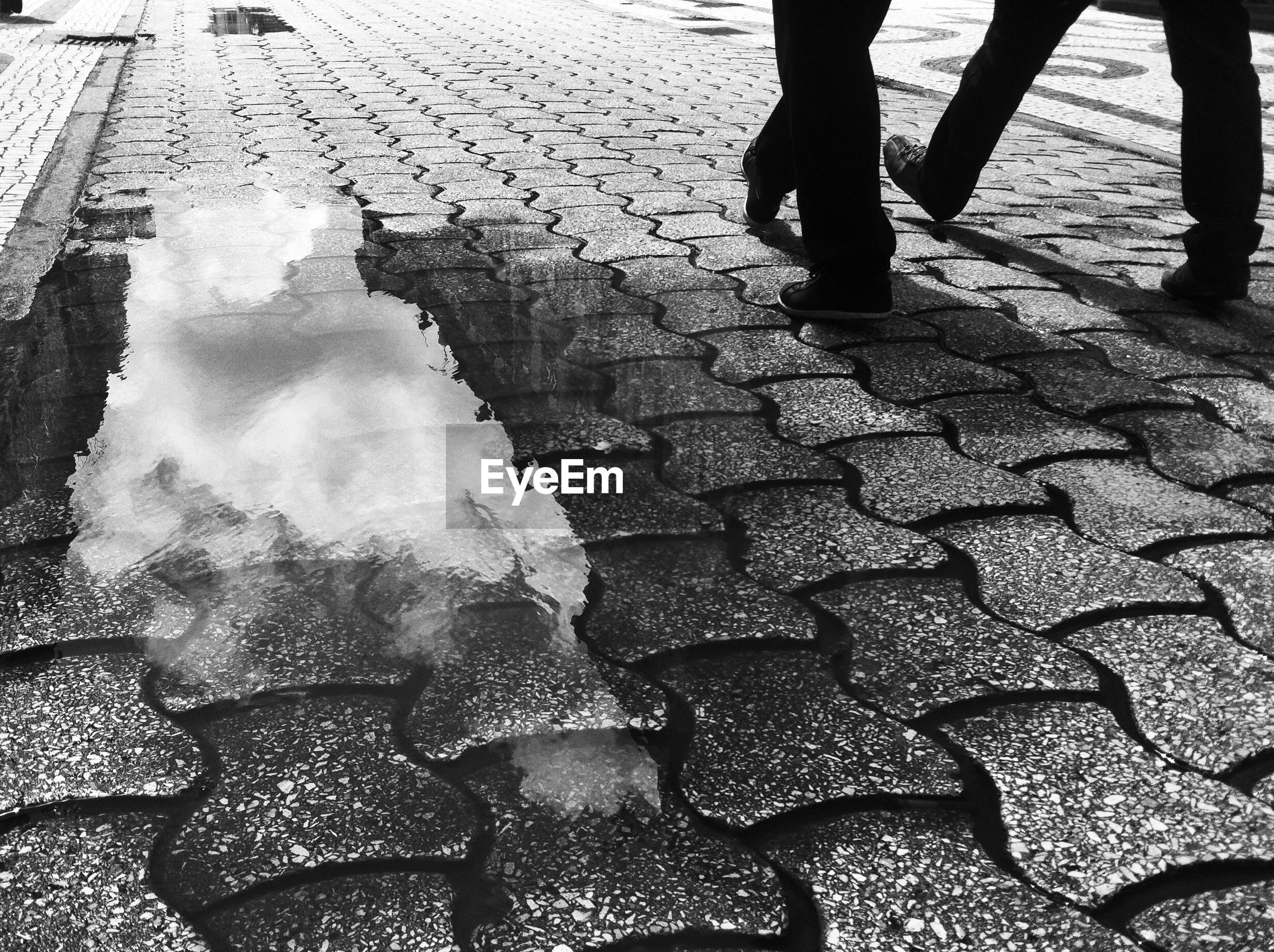 Sky reflecting in puddle