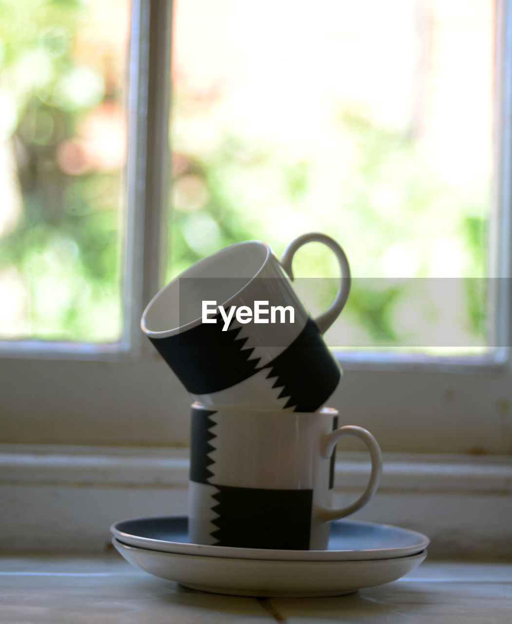 cup, window, drink, mug, indoors, table, refreshment, coffee cup, food and drink, no people, focus on foreground, coffee - drink, coffee, still life, day, crockery, close-up, saucer, hot drink, tea, tea cup, coffee pot