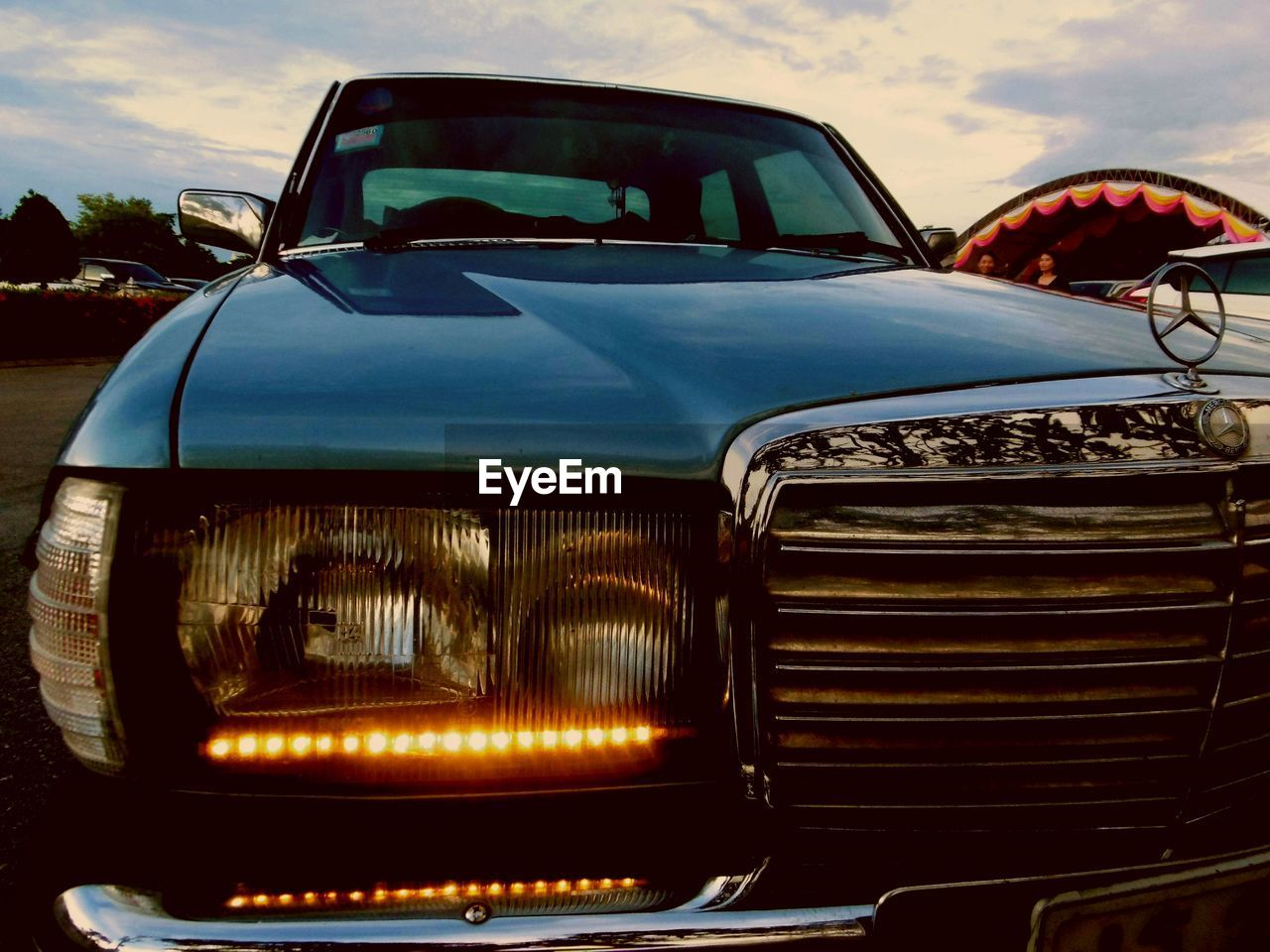 headlight, car, transportation, sky, mode of transport, no people, outdoors, day, close-up