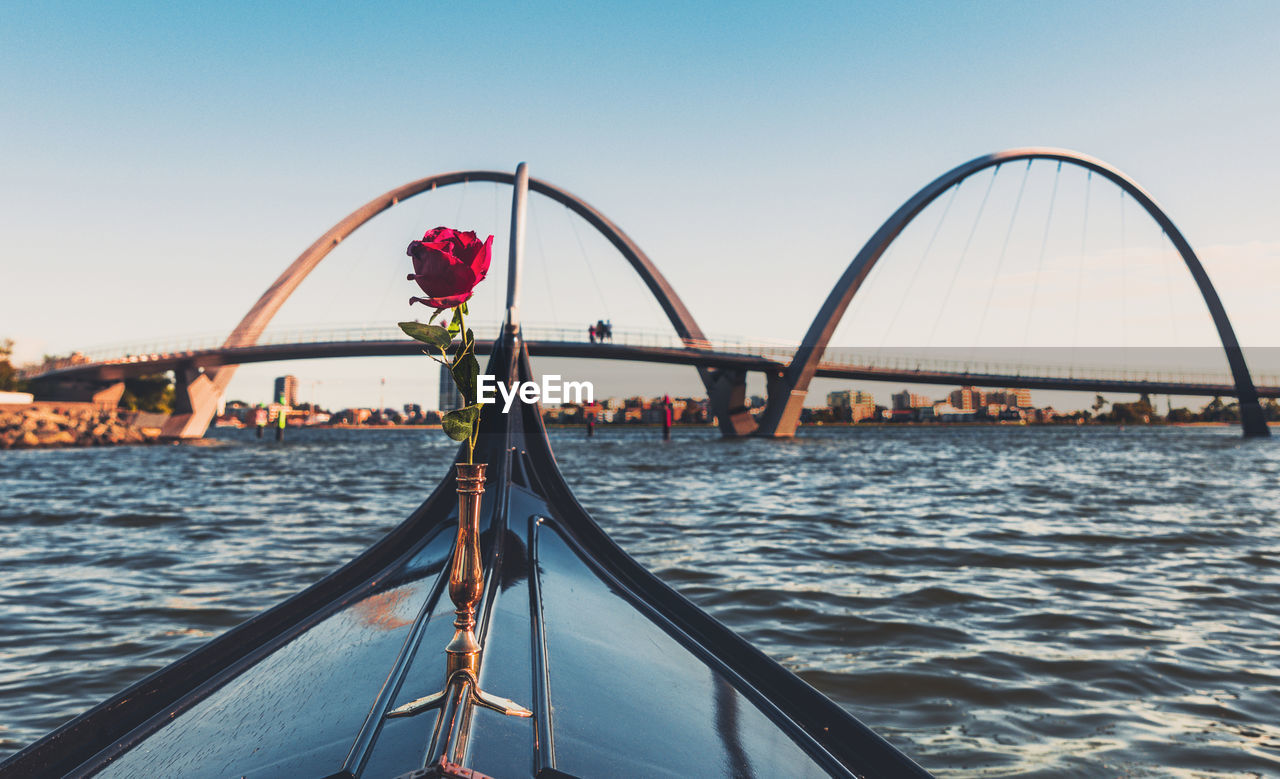 sky, water, transportation, nature, nautical vessel, architecture, travel, travel destinations, sea, mode of transportation, built structure, clear sky, day, bridge, bridge - man made structure, sunset, beauty in nature, outdoors, tourism