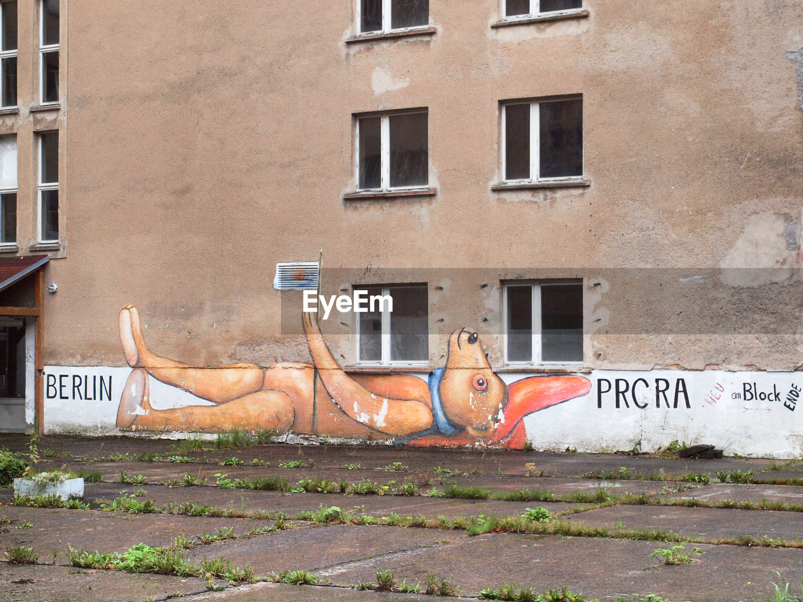 FULL LENGTH OF SHIRTLESS MAN LYING ON BUILDING