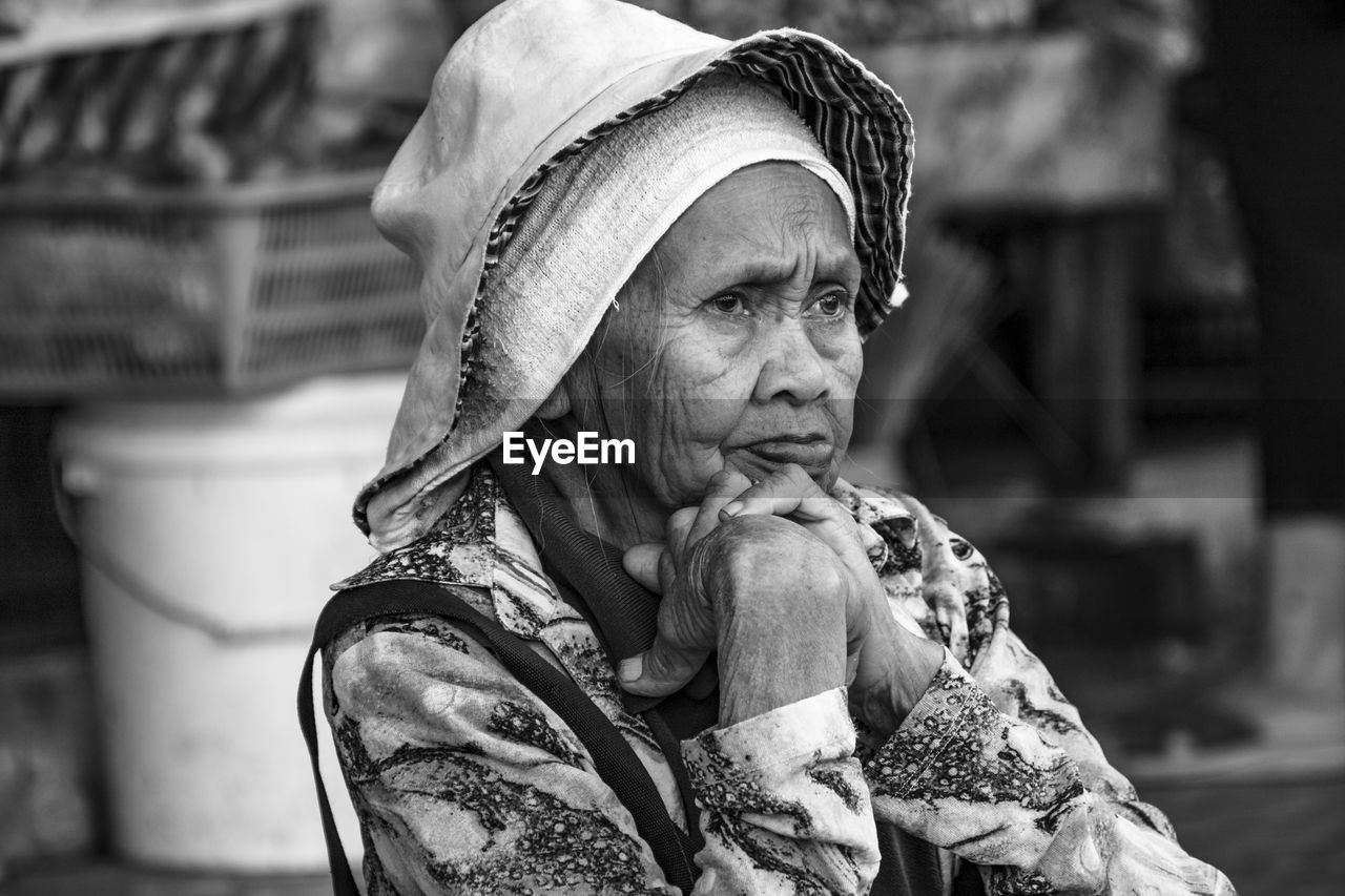 real people, clothing, focus on foreground, one person, lifestyles, portrait, adult, day, hat, senior adult, women, leisure activity, looking at camera, mid adult, waist up, headshot, senior women, social issues