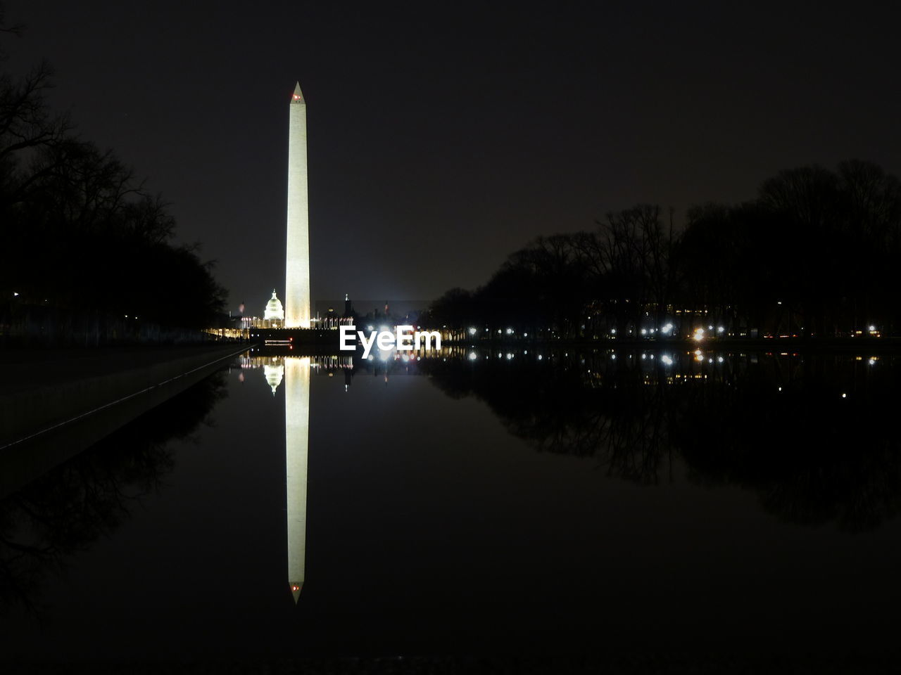 night, reflection, illuminated, travel destinations, architecture, reflecting pool, built structure, symmetry, water, tourism, travel, sky, outdoors, no people, nature, tree, city