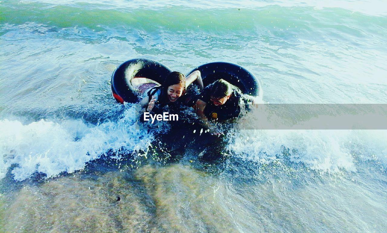 Friends swimming in sea