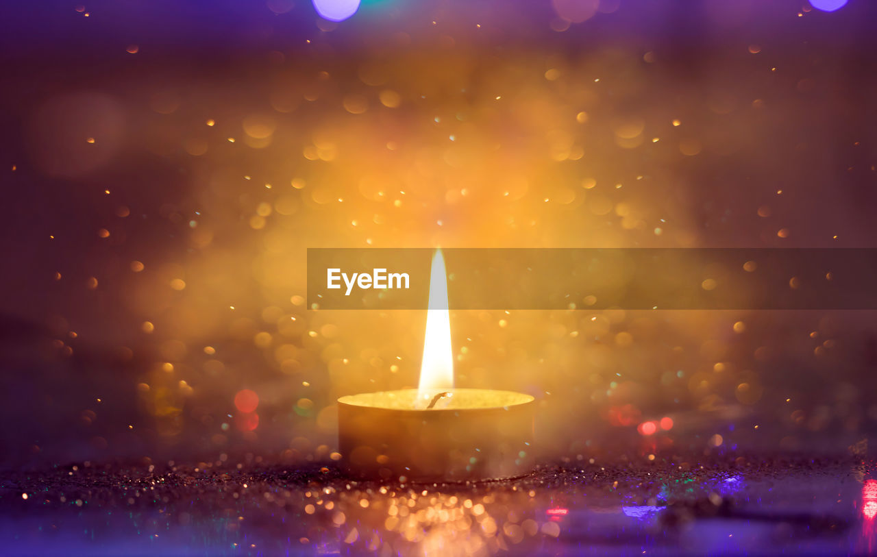 flame, illuminated, burning, fire, nature, heat - temperature, candle, glowing, no people, close-up, fire - natural phenomenon, indoors, motion, celebration, lighting equipment, focus on foreground, lens flare, diwali, electric lamp, melting