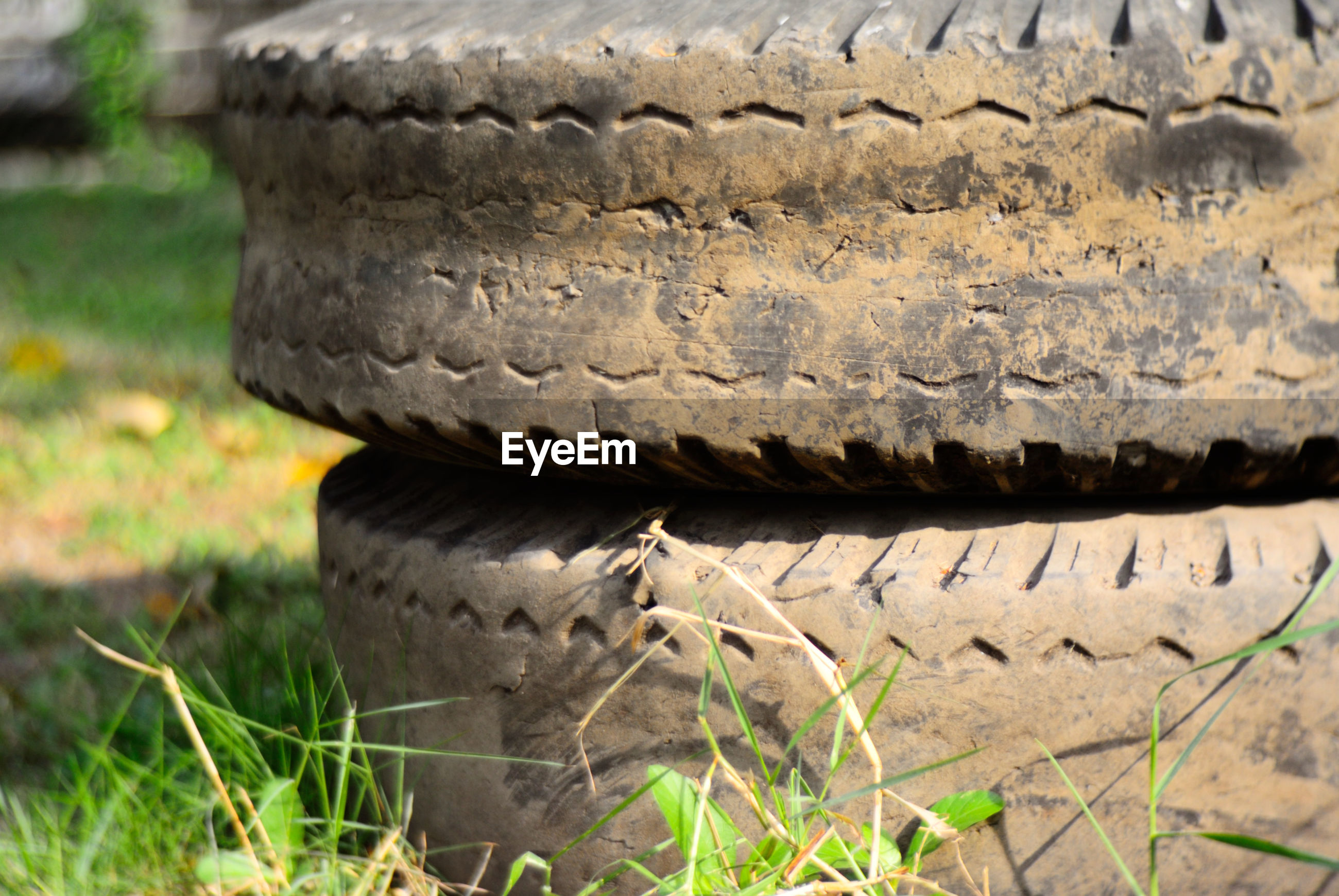 Stack of tires on grassy field