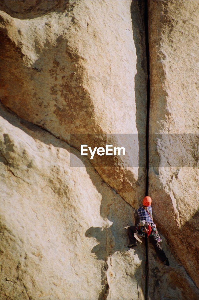 Low angle view of a man rock climbing