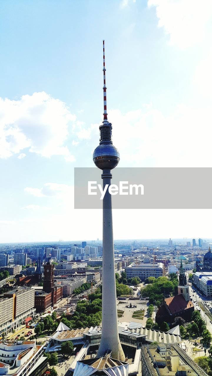 architecture, built structure, city, travel destinations, tower, tall - high, building exterior, cityscape, sky, tourism, day, communication, outdoors, high angle view, travel, no people, television tower, cloud - sky, skyscraper