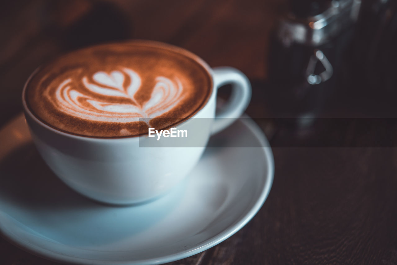 coffee - drink, drink, refreshment, cup, coffee cup, coffee, mug, food and drink, frothy drink, still life, cappuccino, froth art, hot drink, indoors, crockery, table, saucer, freshness, close-up, no people, latte, non-alcoholic beverage